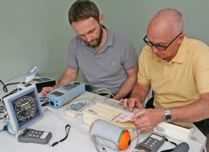 Medical Equipment Calibration - Two engineers looking at a readout