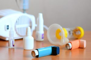 Photo of Medical equipment and drugs for treatment of asthma. Nebulizer, inhaler, spacer, nebula, anti-inflammatory drugs to manage asthma. Bronchi asthma, allergy concept - Manage Asthma Correctly - Asthma Action Plan and Spirometer Medical Equipment Calibration