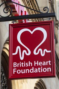 The British Heart Foundation sign outside one of their charity shops - Forest Medical Device Testing