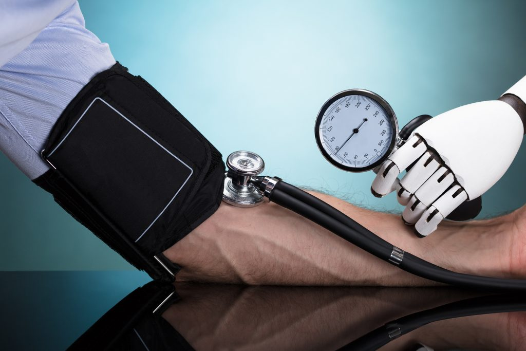 Robot's Hand Checking Person's Blood Pressure On Turquoise Background